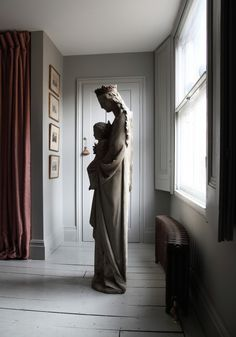 Virgin Mary statue in designer Patrick Williams of Berdoulat's London bedroom | Remodelista