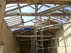 Dépose de la toiture en conservant la charpente d'origine