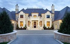 This waterfront mansion, dubbed Bella Vista, is located at 3770 Northome Road on Lake Minnetonka in Wayzata, MN. It was designed by Eskuche Designa and built by John Kraemer & Sons. The stone mansion features Mansion Homes, Dream Mansion, Mansion Interior, Dream Houses, Luxury Estate, Luxury Homes, Stone Mansion, Las Vegas, Mansions For Sale