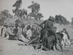 Australian Aboriginal Rites of Passage. Newly initiated men rubbing their blood on the backs of elders.