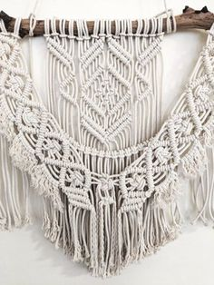 This large macrame wall hanging is made-to-order by Hanifah in Sydney, Australia. Each macrame is a unique and exclusive piece as the drift branch used is different in shape and colour to any other piece. It is a perfect wall-hanging to turn your room into a cosy space.   Measurements: Length 150cm Height 87cm