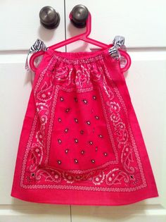 A hot pink BANDANA dress!  Can be found at Giggly Girl Bowtique FB page!