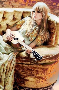That couch! and her dress! and the instrument.