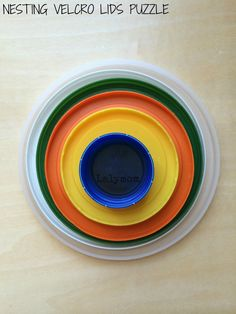 Nesting Velcro Lids Puzzle Fine Motor Activity for Toddlers from Lalymom #SmartMarch #OccupationalTherapy #OT