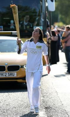 Three-time World Gymnastics Champion Beth Tweddle of Great Britain runs with the 2012 Olympic flame. - www.london2012.com #gymnastics #olympics #london2012