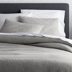 Beautiful Lindstrom offers simple elegance with uniquely crafted, three-dimensional texture. Thick and thin slubbed cotton yarnsare woven in a slightly open weave to create an all-over landscape of touchable texture. Textiles reverse to a herringbone cotton twill back. Duvet has a hidden zipper closure and fabric corner ties to secure the duvet insert. The shams feature an off-center overlap closure secured with three beautiful mother of pearl buttons that add a natural element of…