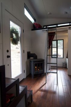 Love the fireplace! Tiny House On Wheels Featuring a Smart and Modern Design I don't like that the outside is a plain box, but the inside isn't half bad. Small Houses On Wheels, Tiny Houses For Sale, Little Houses, Modern Tiny House, Tiny House Plans, Tiny House Design, Tiny House Movement, Design Loft, Design Case