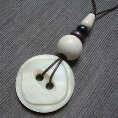 white n dark CHOCOLATE vintage button necklace - very old coat button, wooden beads and leather upcycled into a unique piece