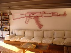 I would absolutely hang this. A giant flocked steel outline of an AK-47.