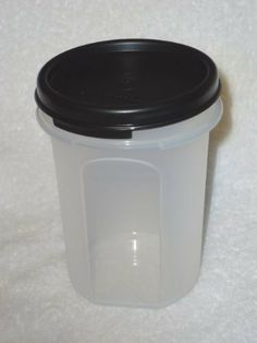 "Tupperware Modular Mates Round #2 14oz Capacity Snack Cup Black Seal by Tupperware. $7.95. Clear container with Black seal. 4.5"" tall, 3"" round. Modular Mates Round 2. Air-tight water-tight seal. Great for pantry and spice storage. Tupperware modular mates round 2 with black seal"