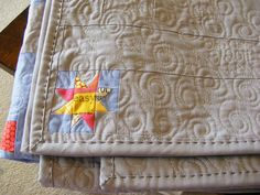 Love the quilting and the label.  I have never seen quilting like that on the binding.