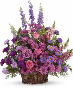 Gracious Lavender Basket-Soothing lavender, respectful purple and compassionate pinks are combined beautifully in this basket overflowing with pretty flowers, sincerity and sympathy. A lovely way to share your thoughts and pay tribute to someone special. A profusion of purple, pink and lavender blooms such as roses, carnations, larkspur, matsumoto and monte cassino asters and much more are delivered in a round wicker basket. #AlsFlorist #HollywoodFlowers #SympathyFlowers