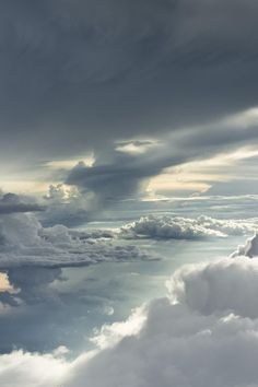 my daughter took her first plane trip, she took beautiful photos of all the clouds! : )