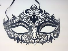 Elegant metal filigree masquerade party mask designed and manufactured in the US by Kayso International Inc.  Rhinestones are hand picked and placed individually.   Wear this exquisite mask to your next masquerade event you will definitely receive compliments.  This classic style from the Renai...