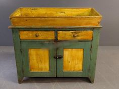 Pine drysink, Circa 1860, with green and yellow paint