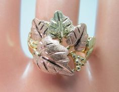 - tri gold (yellow, rose, and green), stamped behind 'leaves' along with designer name. - It's a size and weighs grams. Black Hills Gold Jewelry, I Love Jewelry, Ring Designs, Gold Rings, Vintage Jewelry, Etsy Shop, Earrings, Shower Inspiration, Ebay