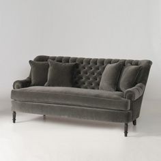 Adler Sofa *perfect balance between past and present, fusing vintage elegance with modern comfort. Handcrafted in the USA, with a deep bench seat, dramatic tufted back, low rolled arms and solid turned wood legs. Available in a variety of upholstery options
