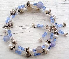 SOLD. Blue, Pearl and Crystal Memory Wire bracelet features Swarovsky crystals, Blue Lace Agate, Button Pearls, Sterling and Hill Tribe Silver components.