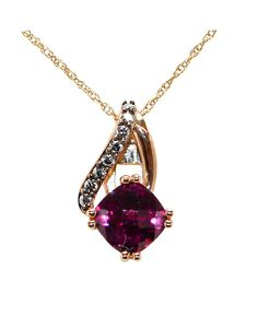 Here is a lovely rhodolite garnet pendant! The 6 mm cushion cut stone has deep violet and red tones that are complemented by the rose gold mounting. The garnet is securely held by four double prongs at the bottom of the pendant. Above, the fancy asymmetrical bail has one polished, shorter side, while the longer side is set with .08 ctw chocolate diamonds. It hangs from a delicate 10k rose gold chain.