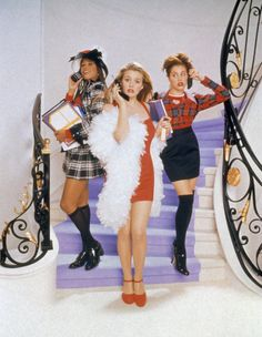 Pin for Later: 4 Easy Ways to Channel the Iconic Cher Horowitz For Halloween  The look: Queen Bee Cher What you'll need: A boa, slinky red dress, matching Mary Janes, and an old-school cell phone