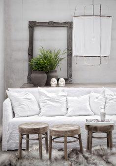 three wooden stool ottomans, fur rug