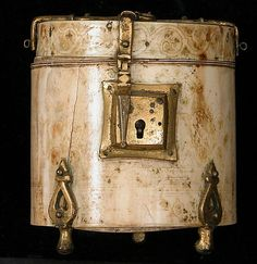 Pyxis with Painted Designs,box. 12th century,Italy,Sicily. ivory,painted,gilded copper alloy mounts.