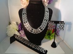 Vintage Silvertone Cuban Chain Chic in the 1980's. The Necklace measures 18 inches. The bracelet measures 7 inches and the pierced earrings are 1.5 inches long and wide. This is an incredible set. This jewelry set is Silvertone and is priced to sell. Listed tonight. Buy it before it is gone. Free Shipping on orders over $50.
