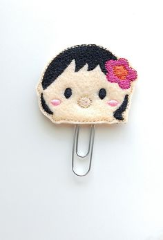 This fun, feltie paperclip has so many uses. Use it to mark specific sections in your planner or keep sheets of paper together on your desk. You can also use it as a bookmark, cookbook recipe marker, school book placeholder, calendar marking, etc. You can also use it to hold coupons together or even to keep your bills (bills never looked so cute :))!  This cute felt applique is securely attached to a 2 silver paper clip.  All felt appliques vary in size and are normally between 1.5 to 1.75…