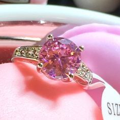 Pink Crystal CZ Ring Size 7  ***This listing is for size 7. Please check my closet for size 6*** Pretty CZ pink sapphire CZ statement ring. Sterling silver .925. stone size is 10mm.  Jewelry Rings