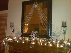 Glass bead strands, vintage pink ornaments, silver snowflakes, and vintage silver reindeer.