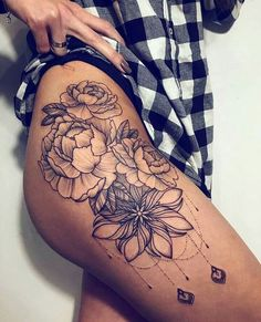 Stunning floral hip tattoos