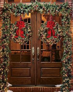 Beautiful Christmas decorated front doors.
