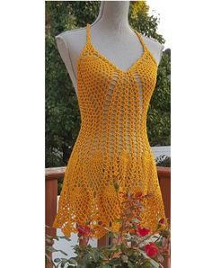 Sexy Beach mini dress Open back , scalloped hemline Crochet Cotton Cover up Yellow Color Best fit for : Bust - 34 - 36 Hips up to 40 30 length One of a Kind, hand made.  Ready to Ship This dress can be made in you size and color just contact me for options. Best quality of handwork from best quality of yarn i guarantee.  Enjoy the Sun and the Ocean breeze.  Stand out in any crowd.  Will be shipped out in 1 business day.