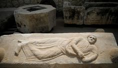 A reclining figure engraved on the lid of a sarcophagus is seen at Israel's National Treasures Storeroom, in Beit Shemesh, Israel March 19, 2017.