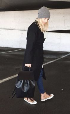 Stand out among other stylish civilians in a black coat and navy skinny jeans. Make khaki high top sneakers your footwear choice for a more relaxed aesthetic.   Shop this look on Lookastic: https://lookastic.com/women/looks/coat-skinny-jeans-high-top-sneakers/17509   — Grey Beanie  — Black Coat  — Navy Skinny Jeans  — Black Leather Backpack  — Tan High Top Sneakers