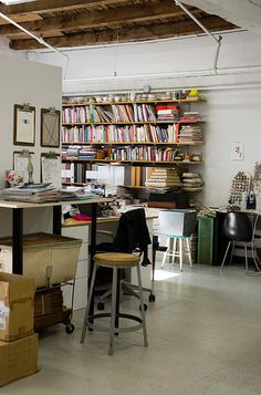 bookshelves, clip boards, and industrial elements. Lotta Jansdotter Studio Tour for decor8, via Flickr.