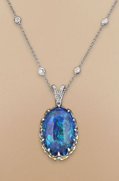 An eye-catching 20.56-carat black opal is the star of this stunning necklace ~ M.S. Rau Antiques