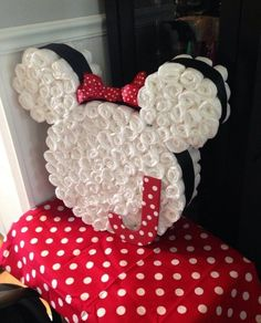 Minnie Mouse. | 31 Diaper Cake Ideas That Are Borderline Genius  www.TopsyTurvyDiaperCakes.com * diaper cakes for baby shower & washcloth favors