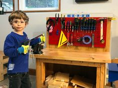 A great action shot of an adorable Junior Maker hard at work on his craft with his Red Wall Control Metal Pegboard keeping his tools out of the way and organized for quick access! Thanks for sending in this fantastic photo Francois!