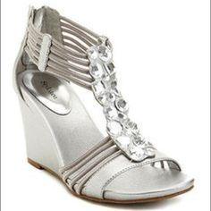 6eb981895 Nikita Wedge Sandals in Silver