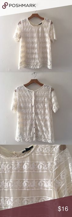 Forever 21 Striped Lace Top Capsleeve lace sheer top from Forever 21. Gently worn and in great condition. No stains. Has button details going down the back. Does have a sheer slip underneath. Forever 21 Tops