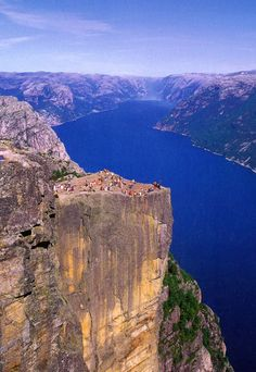 Prekestolen, also known as Preacher's Pulpit   is a 604-meter high mountain cliff above Lysefjorden in Norway. These valleys were created by icebergs that fell as they melted