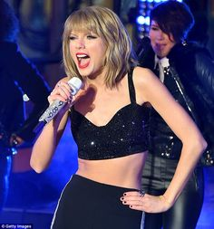 Taylor Swift shivers in tiny vest top as she leads Times Square New Year's Eve bash | Daily Mail Online