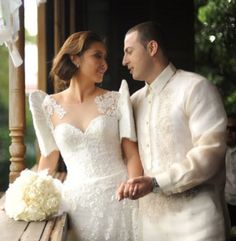 Filipiniana inspired butterfly sleeves wedding dress and barong on groom...