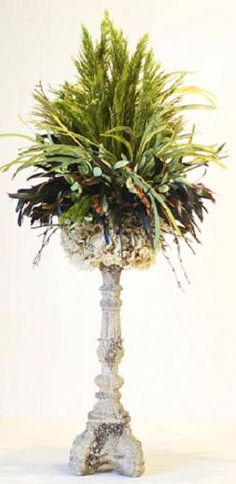 Our glassy tall ornate candlestick featuring our natural preserved hydrangea in layers of feathers, plum reed greenery, and other selected artificial greenery. Silk Floral Arrangements, Vase Arrangements, Church Flowers, Topiary, Silk Flowers, Flower Vases, Flower Decorations, Centerpiece Ideas, Centerpieces