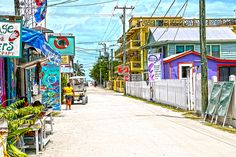 Sandy streets and a go slow lifestyle on Caye Caulker where bicycles, feet and a few golf carts are the main form of transportation on this little island located 20 miles offshore where I have lived the past 15 years. Caye Caulker Belize, Latin America, Passion, Wall Art, Purple, Photos, Travel, Scenery, Pictures