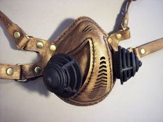 Tom Banwell—Leather and Resin Projects: Ronin: Respirator Gas Mask Tutorial Check out the artist's site. He really does awesome work and is even generous enough to offer some patterns and parts so that you can DIY!