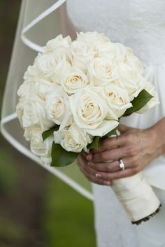 white roses bouquet wedding but with tiffany blue satin ribbon for the bridesmaids.