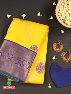 The fine craftsmanship of this yellow with purple silk saree stands out, the golden prints and contrasting shades of zari and the green patterns in the body of the saree reflect the style that is magnificent and ethnic. #silksaree #puresilk #saree #traditionalsaree #sareedesigns #sareestyles #weddingsaree #sareelook #diwali #bridalsaree #sareeembroidery #diwalispecial #diwalicollection #softsilksaree #silksareeblouse #weddingsilks #kancheepuramsilk #weddingblouse #southindianwedding #pothys