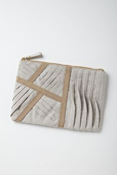Fabric Manipulation for fashion - purse design with decorative wave tucks; creative sewing techniques #textiles // Anthropologie